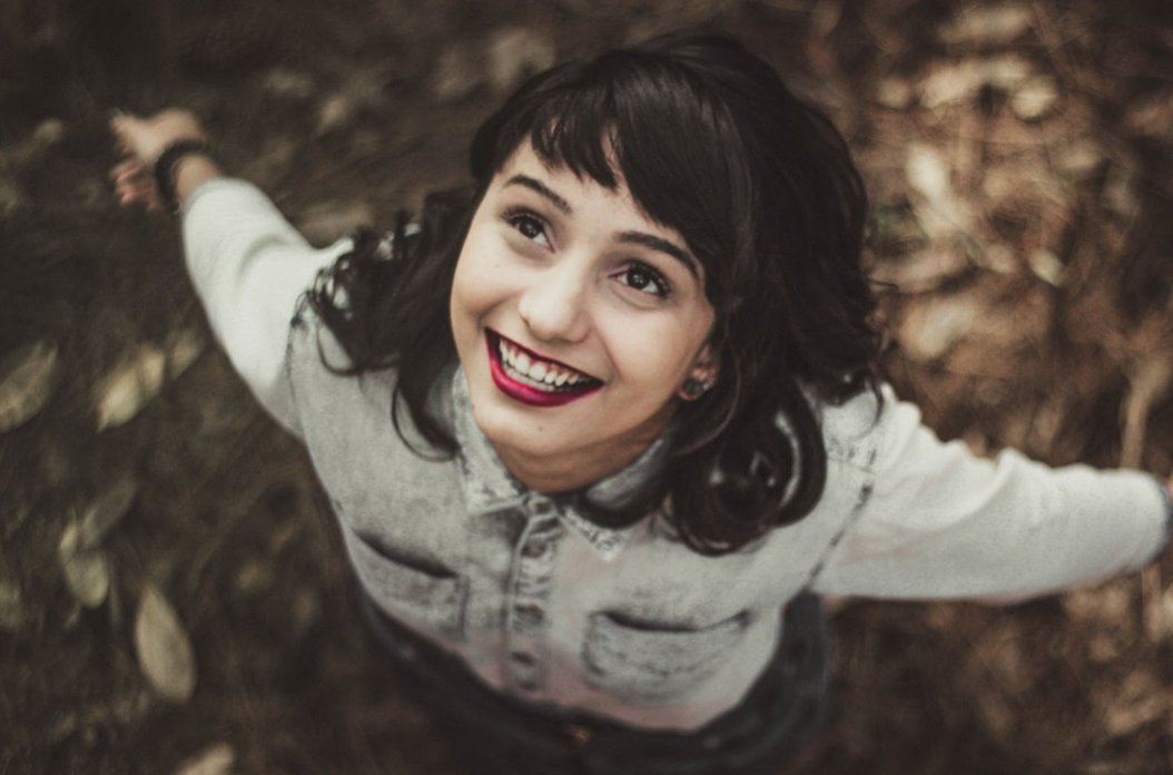 Happy young woman (Photo by Allef Vinicius on Unsplash)