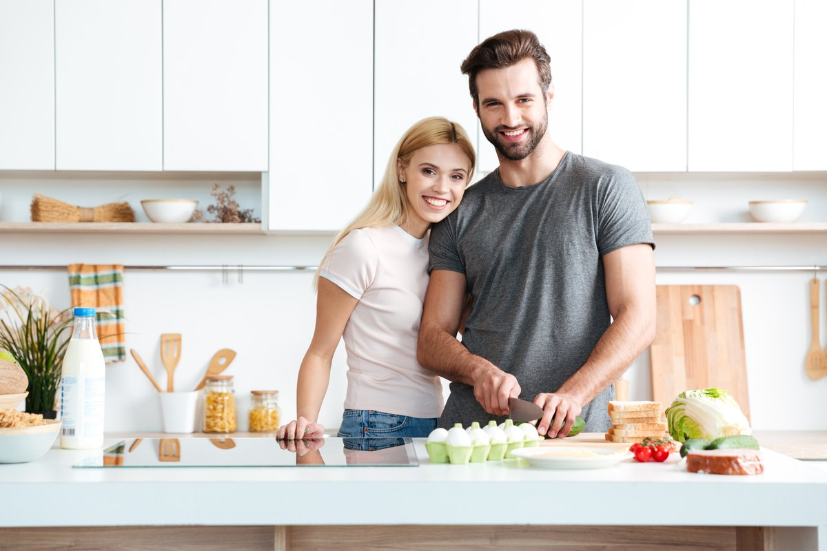 storyblocks-married-young-couple-enjoying-their-time-at-home-while-cooking-in-the-kitchen_rRMNmaoTcW.jpg